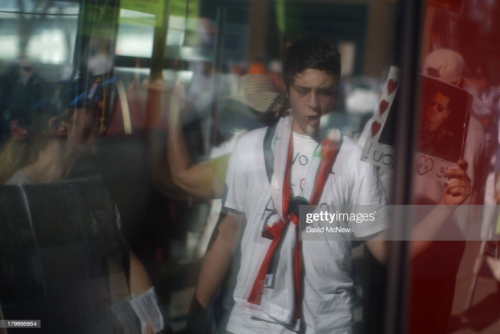 Protesters are reflected in a public transit bus as they chant at the riders inside during a rally to urge Congress to vote against a limited military strike against the Syrian military in response to allegations that President Bashar Hafez al-Assad has used sarin gas to kill civilians on September 7, 2013 in Los Angeles, California. The Obama administration claims to have clear evidence that the Syrian military broke international law by killing nearly 1,500 Syrian civilians, including at least 426 children, in a chemical weapons attack on August 21, and is seeking the support of Congress for a missile strikes to prevent future chemical weapons attacks by the regime and other nations.