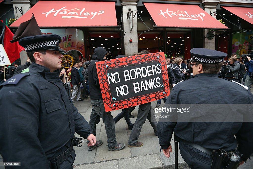 Protesters are seen at the start of a demonstration on Oxford Street as part of a protest ahead of next week's G8 summit in Northern Ireland on June 11, 2013 in London, England. Next week will see Enniskillen in Northern Ireland host the two day G8 summit where international leaders including Britain's Prime Minister David Cameron and US President Barack Obama take part in the two day event. The chosen location is only 8 kilometers from the scene of one of Northern Ireland's worst killings back in 1987, however Cameron is confident that it's secluded location will deter any potential trouble.