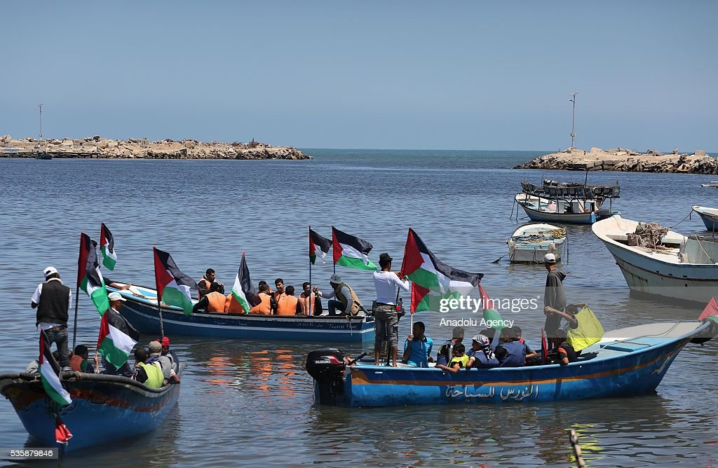 Protesters are seen on boats during a protest, staged against Israeli Authorities' blockade on Gaza in Gaza City, Gaza on May 30, 2016.