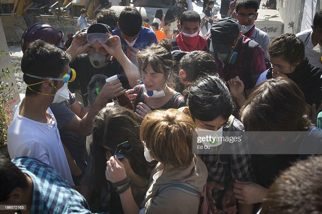 Protesters are sprayed by an antidote after being exposed to teargas fired by the police during a clash in Istanbul Turkey on June 11 2013 A large...
