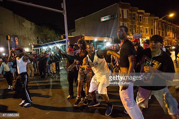 Protesters argue near a CVS pharmacy that was looted and burned by rioters on Monday after the funeral of Freddie Gray on April 29 2015 in Baltimore...