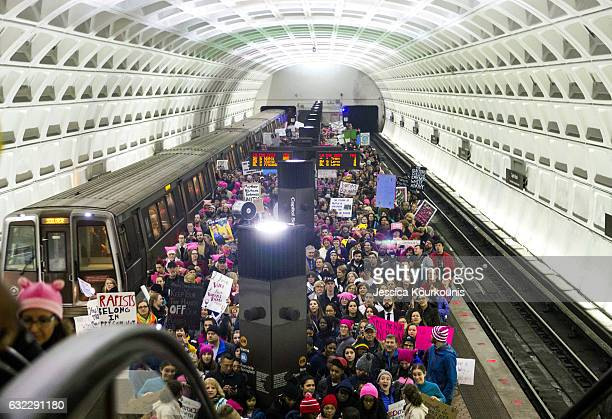Protesters arrive on the platform at the Capital South Metro station for the Women's March on Washington on January 21 2017 in Washington DC...