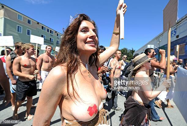 Protesters attend a demonstration during the 'National Go Topless Day' to honor Women's Equality Day at Venice Beach in Los Angeles on August 22 2010...