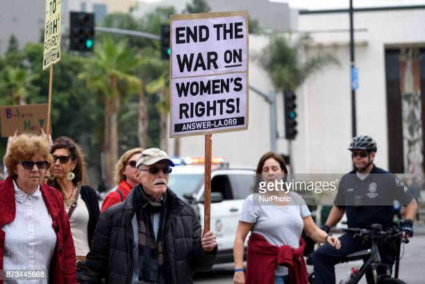 Protesters attend a Me Too rally to denounce sexual harassment and assaults of women in Los Angeles California on November 12 2017 The rally is...