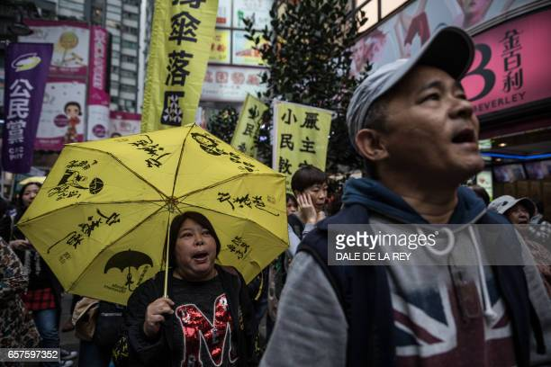 TOPSHOT Protesters attend a prodemocracy rally in Hong Kong on March 25 2017 Protesters demonstrated ahead of the March 26 vote for the city's new...
