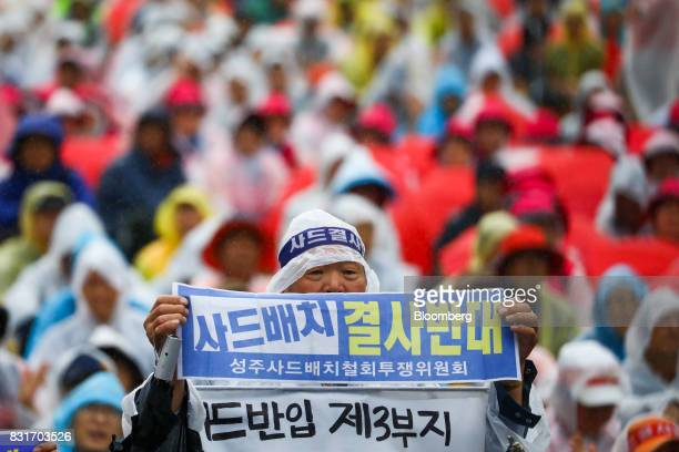 Protesters attend a rally against the deployment of the Terminal HighAltitude Area Defense system in Seoul South Korea on Tuesday Aug 15 2017 In a...