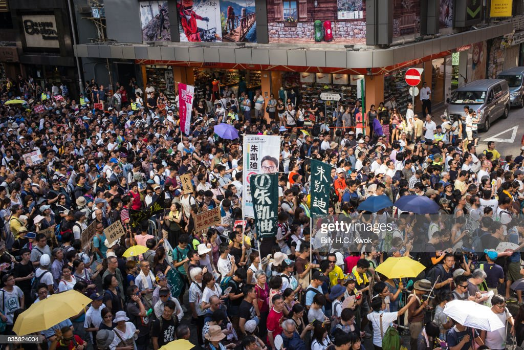 Protesters attend a rally to support young activists Joshua Wong, Nathan Law and Alex Chow in Wanchai on August 20, 2017 in Hong Kong, Hong Kong. Pro-democracy activists Joshua Wong, Nathan Law and Alex Chow were jailed last week after being convicted of unlawful assembly.