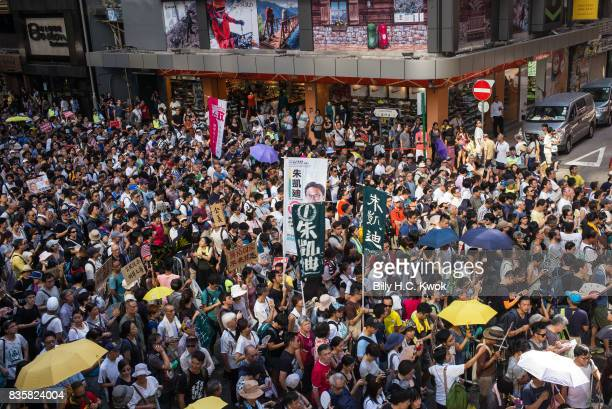 Protesters attend a rally to support young activists Joshua Wong Nathan Law and Alex Chow in Wanchai on August 20 2017 in Hong Kong Hong Kong...