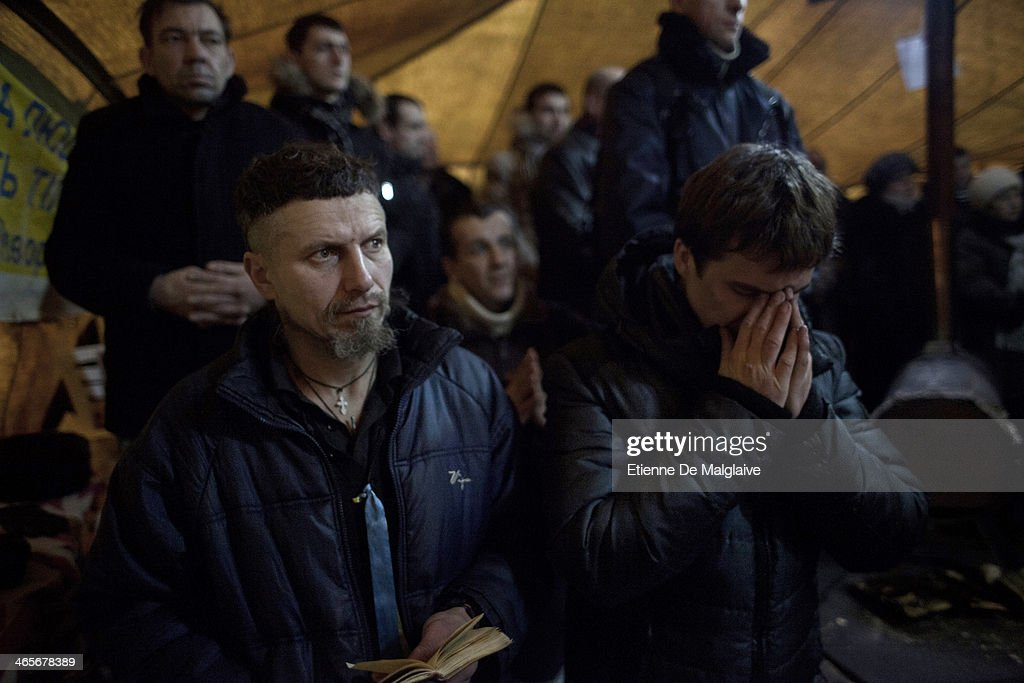 Protesters attend a religious service in a chapel set up inside a tent on Maidan Square on January 28, 2014 in Kiev, Ukraine. While Ukrainian parliament holds an emergency session, standoff between anti-government protesters and riot police continue s on Hrushevskoho street.