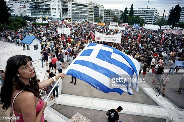 Protesters attend an antiausterity progovernment rally in front of the parliament building on June 21 2015 in Athens Greece Greece's leftwing...