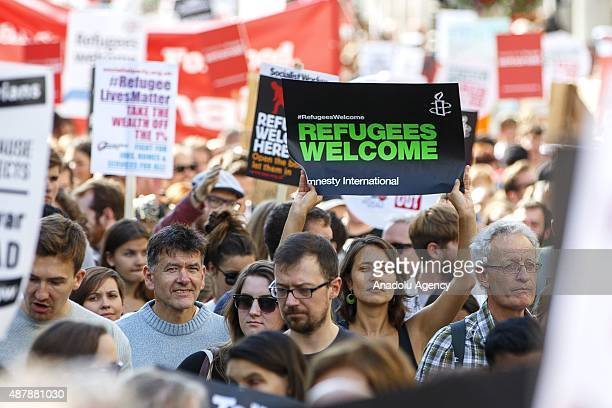Protesters attending a prorefugee march in London England on September 12 2015 Prorefugee demonstrators demand the UK government to help more...