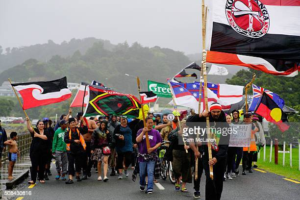 Protesters battle the rain on the way to the lower Marae on February 5 2016 in Waitangi New Zealand The Waitangi Day national holiday celebrates the...