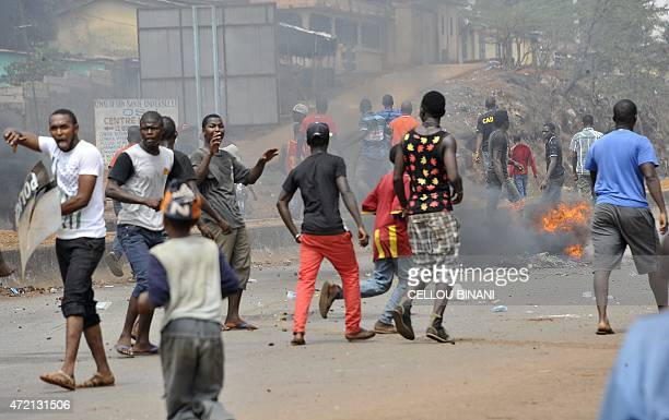 Protesters block a street in Conakry on May 4 2015 during fresh demonstrations against the timetable set down for presidential and local elections...
