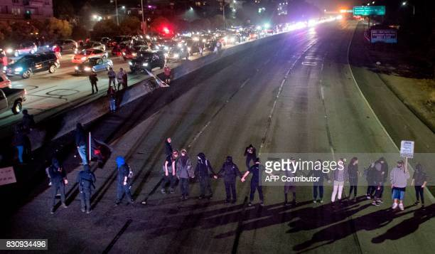 Protesters block both directions of the Interstate 580 freeway during a rally against racism in Oakland California on August 12 2017 Protesters...