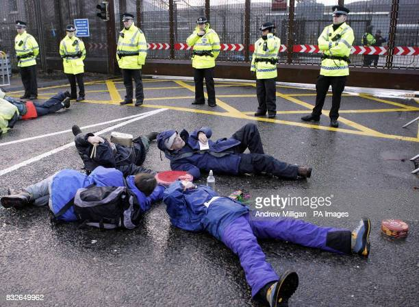 Protesters block the entrance to Faslane on the River Clyde Scotland the Trident nuclear submarine base