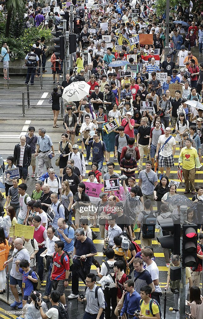 Protesters brave the rain and march toward the US Consulate from Centra, Hong Kong in support of Edward Snowden on June 15, 2013 in Hong Kong, Hong Kong. Former CIA employee Edward Snowden is accused of leaking details of top-secret US surveillance of phones and internet.