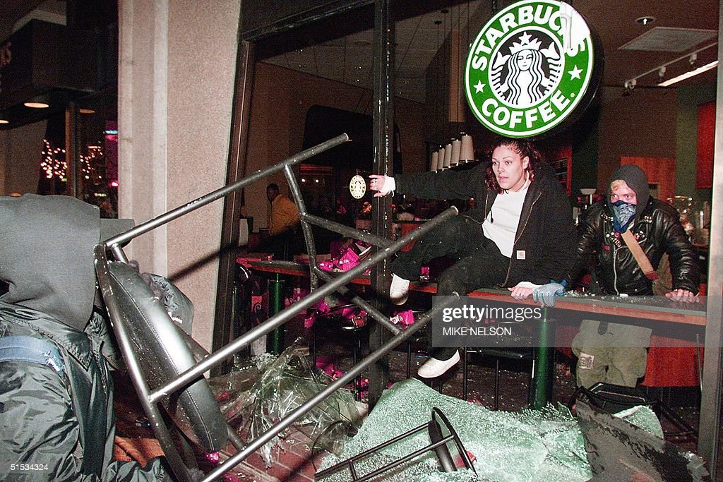 http://media.gettyimages.com/photos/protesters-break-and-trash-a-starbucks-coffee-shop-during-widespread-picture-id51534324