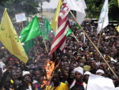 Protesters burn a US flag during a demonstration in the city of Kaduna in Nigeria's mainly Muslimpopulated north against a USmade film which mocks...
