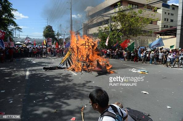 Protesters burn an effigy of an American eagle during a demonstration against the AsiaPacific Economic Cooperation Summit currently taking place in...