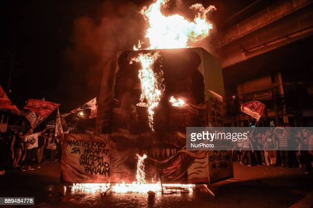 Protesters burn an effigy of Philippine President Rodrigo Duterte during Human Rights Day protests in Manila Philippines December 10 2017 On...
