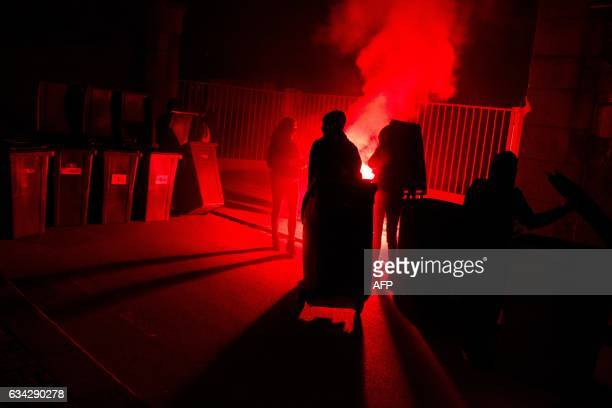 TOPSHOT Protesters burn garbage containers during a protest in support of a man allegedly abused while in police custody in AulnaysousBois on...