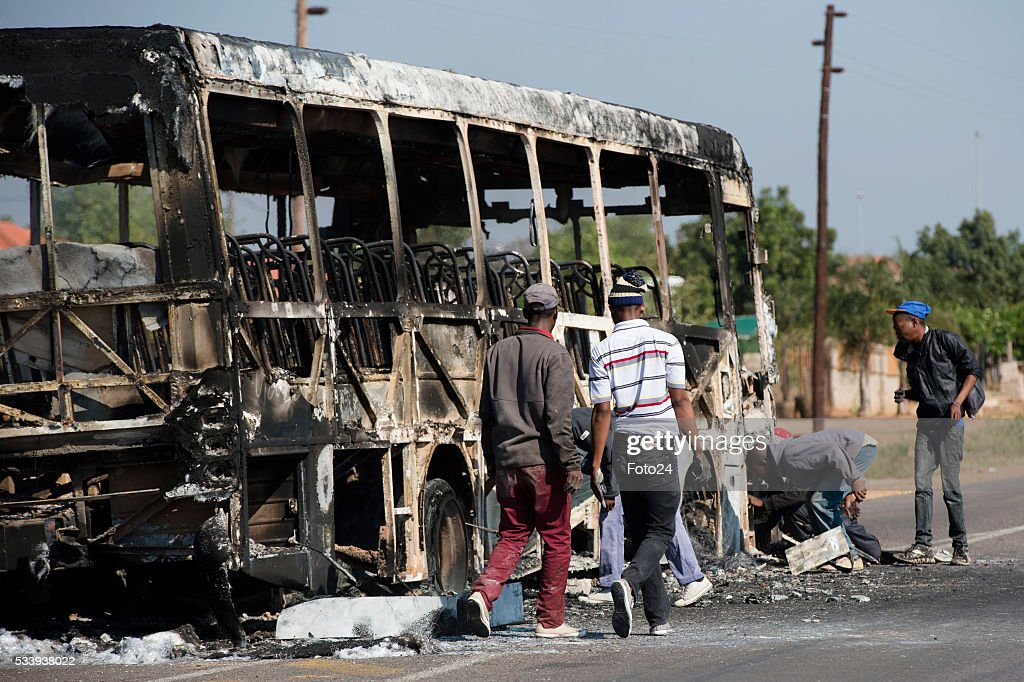 Protesters burn properties and barricade the roads during protest against eviction on May 23, 2016 in Hammanskraal, South Africa. Residents have vowed to continue their protest against being evicted from Sekampangeng, a township inside Hammanskraal.