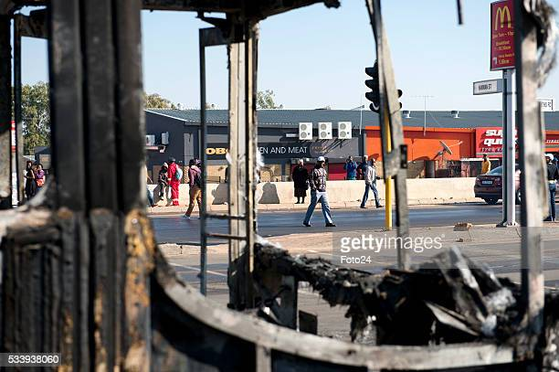 Protesters burn properties and barricade the roads during protest against eviction on May 23 2016 in Hammanskraal South Africa Residents have vowed...