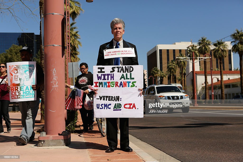 Protesters call for immigration reform outside the U.S. Immigration and Customs Enforcement (ICE), office on March 11, 2013 in Phoenix, Arizona. The march called for an end to ICE deportation, family separation and workplace raids on immigrants.