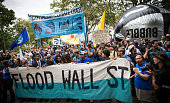 Protesters calling for massive economic and political changes to curb the effects of global warming prepare to march from Battery Park to Broadway in...