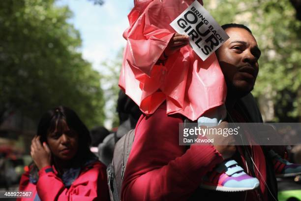 Protesters calling for the release of a group of abducted Nigerian schoolgirls gather outside Nigeria House on May 9 2014 in London England 276...