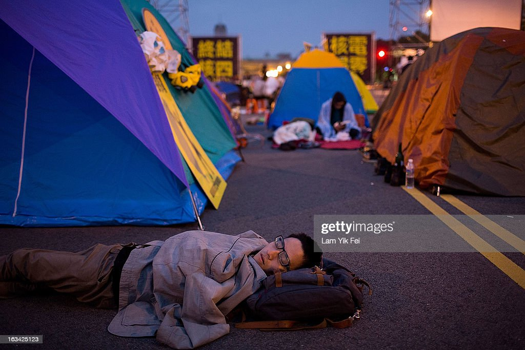 Protesters camp outside the Taiwan presidential palace overnight on March 10, 2013 in Taipei, Taiwan. Tens of thousands of protesters took to the streets in Taiwan calling on the government to shut down the island's nuclear power plants, citing the painful lesson of Japan's nuclear crisis after a 9.0-magnitude earthquake two years ago.