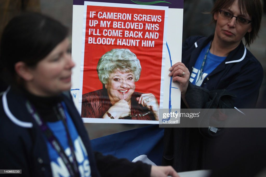 Protesters campaign against the government's proposed Health and Social Care Bill outside the Houses of Parliament on March 7, 2012 in London, England. The Coalition government's plans to restructure the National Health Service have met with strong criticism from health care workers who claim that the bill amounts to a privatisation of England's health services.