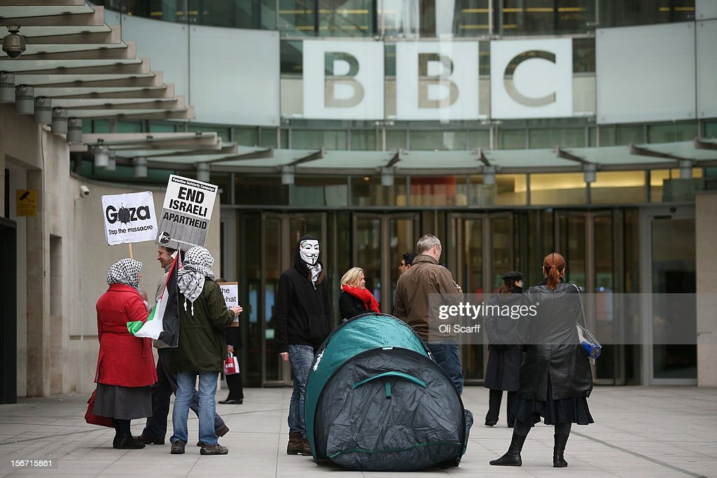 Protesters, campaigning against perceived bias in the BBC's coverage of the situation in Gaza, demonstrate outside New Broadcasting House on November 19, 2012 in London, England.