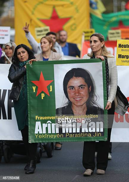 Protesters carry a banner showing a portrait of Kurdish fighter Arin Mirkan who blew herself up with explosives in an attack against Islamic State...