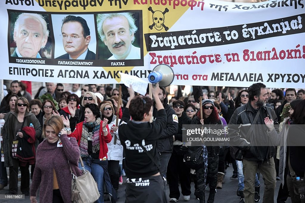 Protesters carry a banner with pictures of former Greek ministers who approved a gold mine project and reading 'Stop the Crime' on January 12, 2013 in the center of Athens during a demonstration against a Canadian gold mining investment in the northern region of Halkidiki that is feared to be causing irreversible damage to the local environment. A number of citizens' groups, backed by the radical leftist party Syriza that is now the second largest group in parliament, have been trying to scupper the project since 2011, when the government allowed Hellenic Gold -- a subsidiary of Canadian firm Eldorado Gold -- to dig in the area. AFP PHOTO/ LOUISA GOULIAMAKI