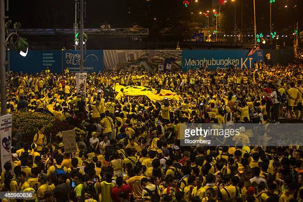 Protesters carry a large banner around the Dataran Merdeka during the Coalition for Clean and Fair Elections rally also known as Bersih in Kuala...