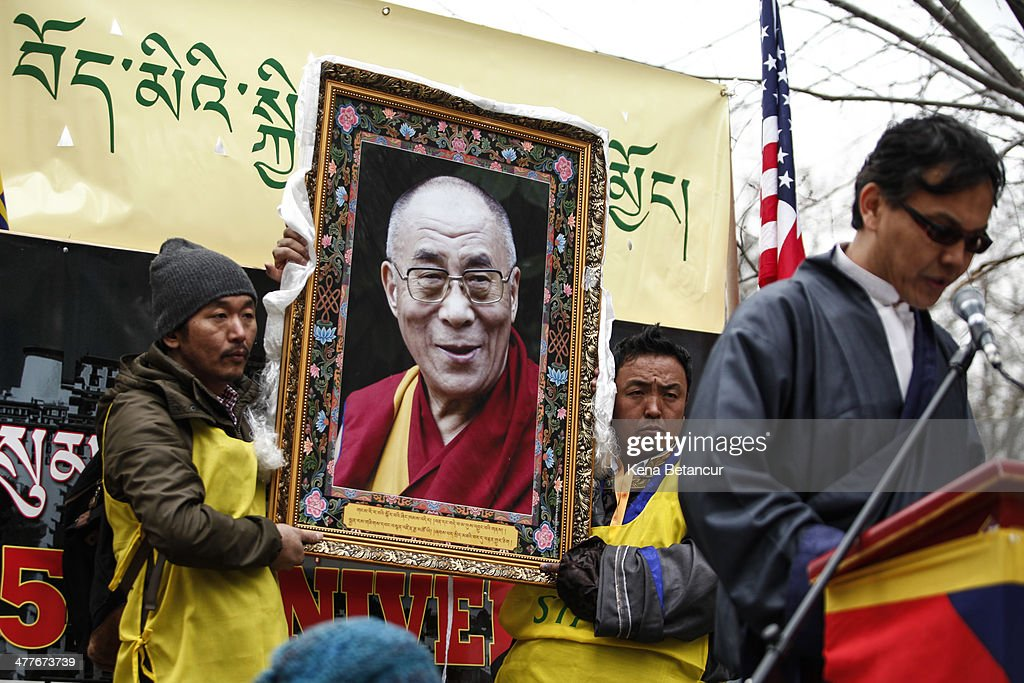 Protesters carry a portrait of the Dalai Lama at a rally to mark the 55th anniversary of the Tibetan national uprising outside the United Nations building on March 10, 2014, in New York City. On this day in 1959, an uprising against China's occupation of the autonomous region of Tibet took place, forcing spiritual leader the Dalai Lama to flee into exile.