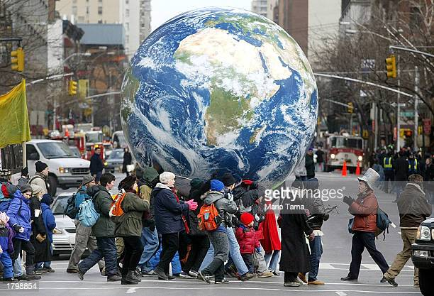 Protesters carry an inflatable globe during an antiwar demonstration February 15 2003 in New York City Tens of thousands attended the rally which...