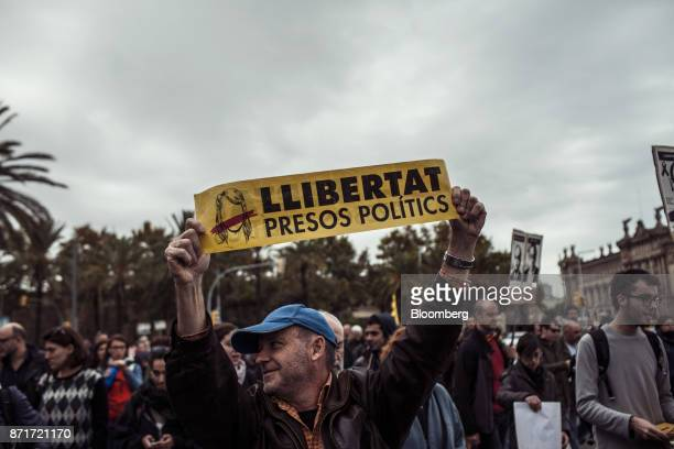 Protesters carry banners demanding 'Freedom for political prisoners' along Paralelo Avenue during a regional strike called by proindependence union...