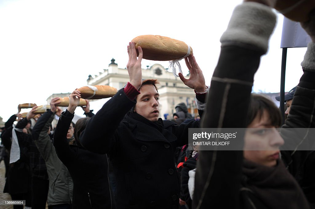 Protesters carry bread loaves in front of the parliament building during a rally against the exploration work of shale gas in central Sofia on January 14, 2012. Thousands of Bulgarians gathered at rallies across the country carrying banners 'No to shale gas, Yes to nature' and 'Chevron go home' to protest the US company plans to drill for shale gas in Bulgaria. The country's reserves are estimated at between 300 billion and 1 trillion cubic metres of shale gas, Energy Minister Traicho Traikov had said citing data by companies willing to explore.