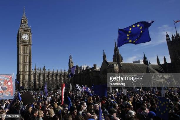 Protesters carry European Union flags in front of Elizabeth Tower commonly referred to as Big Ben during a Unite for Europe march to protest Brexit...