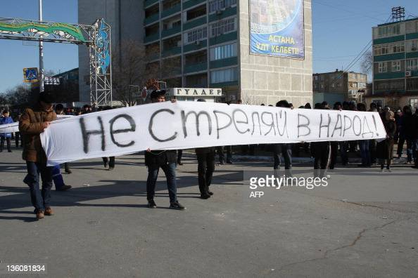 Protesters carry on December 18 2011 a banner reading 'Don't shoot people' during a rally in the Kazakh town of Aktau in the oilrich Mangistau region...
