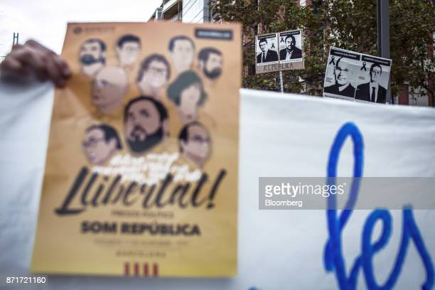 Protesters carry photographs of Catalan activists Jordi Sanchez and Jordi Cuixart and call for 'Freedom for political prisoners' during a regional...