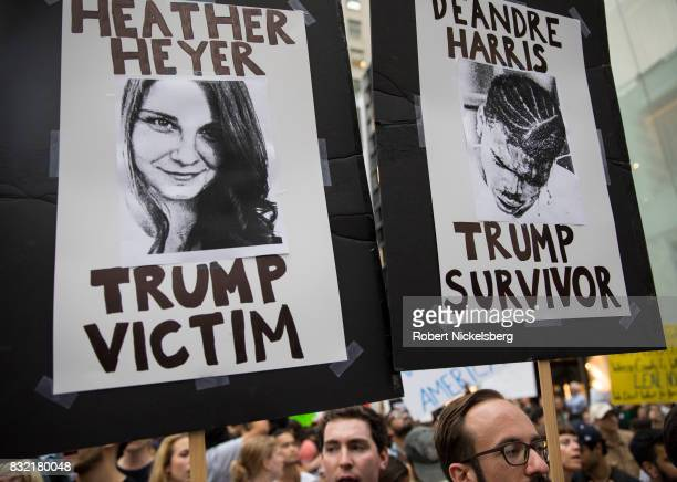 Protesters carry posters of Heather Heyer and Deandre Harris during an antiPresident Donald Trump demonstration outside of Trump Tower August 14 2017...