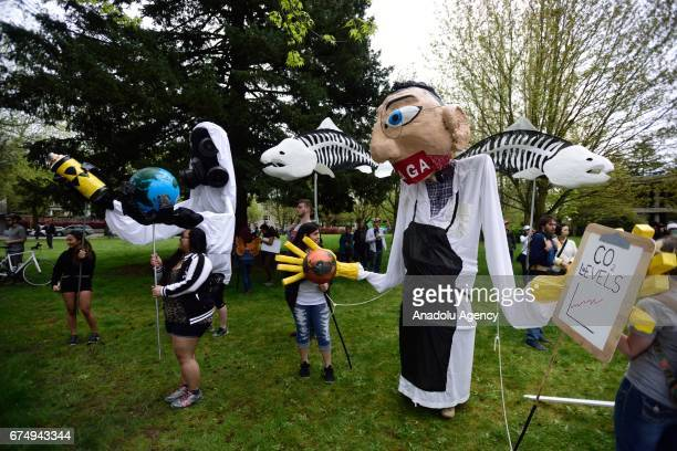 Protesters carry scientists during the People's Climate March in Portland Ore United States on April 29 2017 Thousands turned out in solidarity with...