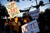 Protesters carry signs for various causes outside Hofstra University prior to the second presidential debate on October 16 2012 in Hempstead New York...
