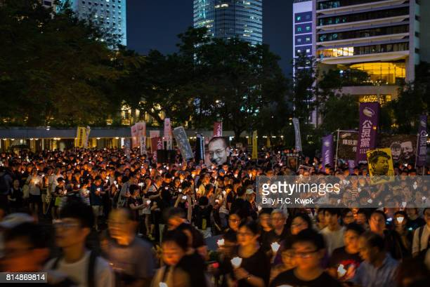 Protesters carrying candles take part in a march to mourn the death of Nobel laureate Liu Xiaobo on July 15 2017 in Hong Kong Hong KongThe body of...