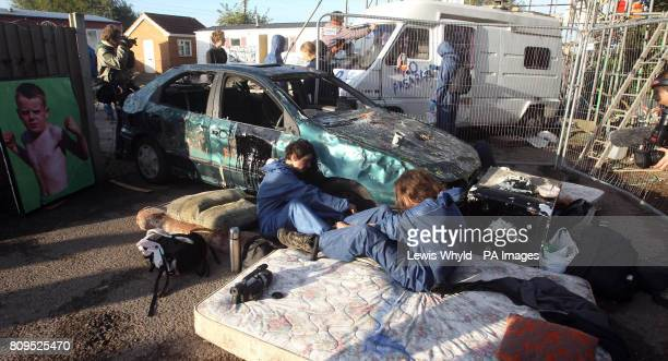 Protesters chain themselves to a car at the Dale Farm travellers site at Cray's Hill near Basildon Essex where bailiffs will later this morning begin...