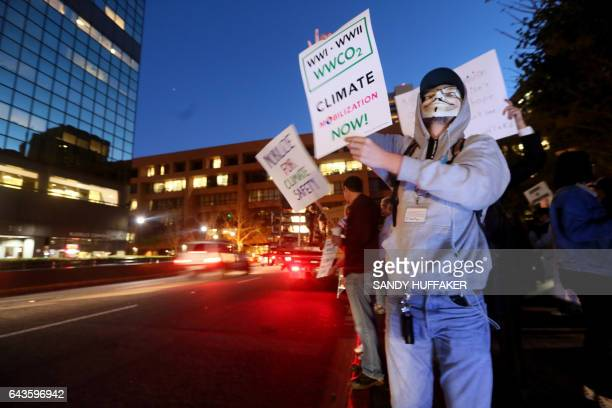 Protesters chant during a rally against climate change in San Diego California on February 21 2017 The US Senate confirmed fossilfuel ally and global...