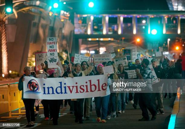 Protesters chant during a rally against the travel ban at San Diego International Airport on March 6 2017 in San Diego California US President Donald...